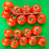 Branches of red tomatoes — Stock Photo