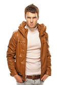 Young man in brown jacket — Stock Photo