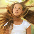 Beautiful girl with hair that wind is blowing — Stock Photo