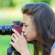 Young womphotographed on red camera — Stock Photo #19127747