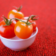 Tomatoes in white plate — Stock Photo