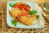 Fish and tomatoes in plate — Stock Photo