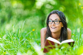 Dark-haired young woman reading red book — Stock Photo