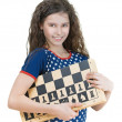Smiling schoolgirl with chess board — Stock Photo