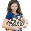 Smiling schoolgirl with chess board — Stock Photo #20355365