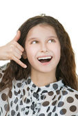 Smiling schoolgirl simulates talking on phone — Stock Photo
