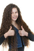 Smiling schoolgirl raises thumbs-up — Stock Photo