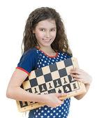 Colegiala sonriente con tablero de ajedrez — Foto de Stock