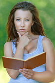 Portrait of attractive girl reading book — Stock Photo