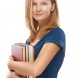 Beautiful young woman with books — Stock Photo #20588001