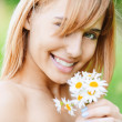 Stock Photo: Girl with bouquet of camomiles