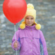 Smiling little girl with red balloon — Stock Photo #21624369