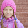 Smiling little girl in pink coat — Stock Photo