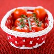 Basket with ripe tomatoes - 图库照片
