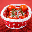 Basket with ripe tomatoes - Foto Stock