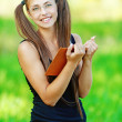 Smiling woman read book — Stock Photo