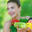 Happy beautiful young woman with vegetables — Stockfoto