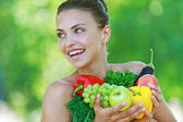 Happy beautiful young woman with vegetables — Stock Photo