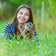 Smiling woman with Yorkshire Terrier — Stock Photo