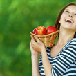 Woman holding basket with apples — Stock Photo #24054275