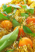 Tangerines in ornaments — Stock Photo