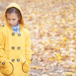 Sad beautiful girl in yellow jacket — Stock Photo