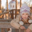 Smiling little girl in winter jacket - Stockfoto