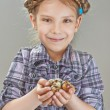 Little girl with quail eggs - Stock Photo