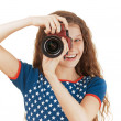 Smiling little girl in stars dress with camera — Stock Photo