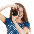 Smiling little girl in stars dress with camera - Stock Photo