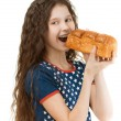 Schoolgirl biting off piece of bread — Stock Photo