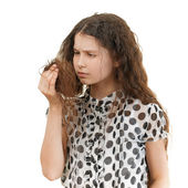 Sad schoolgirl unhappy with her hair — Stock Photo
