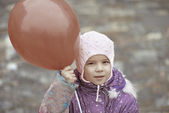 Little girl with red balloon — Stock Photo