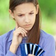 Teenage girl shows credit card — Stock Photo #25191067