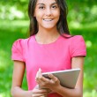Dark-haired young woman with e-book — Stock Photo #25456191