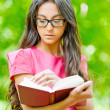 Woman glasses holds book — Stock Photo