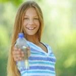 Teenage girl with water bottle — Stock Photo #25829999