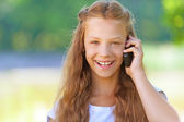 Teenage girl talking on mobile phone — Stock Photo