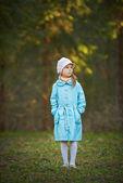 Little girl in blue coat — Stock Photo