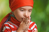 Small, sad little girl looking down — Stock Photo