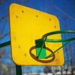 Stock Photo: Yellow basketball backboard with ring