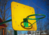 Yellow basketball backboard with ring — Stock Photo