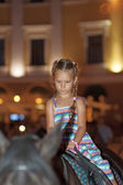 Little girl riding horse — Stockfoto