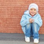 Beautiful little girl sitting — Stock Photo