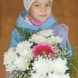 Little girl with bouquet of flowers — Stock Photo