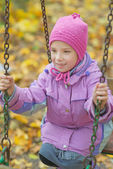 Girl riding on swing — Stock Photo