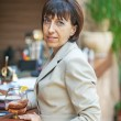 Business woman holding glass of wine — Stock Photo