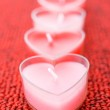 Pink candles in form of heart — Stock Photo #27954851