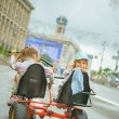 Two little girls riding toy cycle — Stock Photo