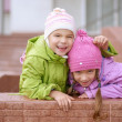 Young sisters laughing and hugging — Stock Photo